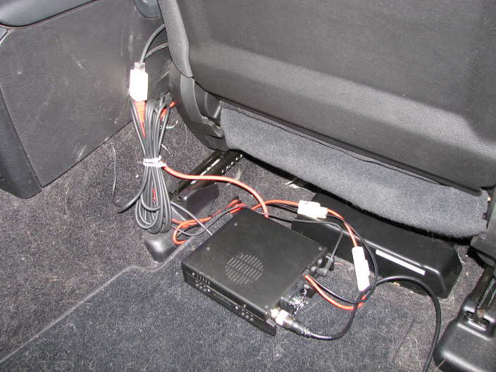 Remote unit mounted under passenger seat